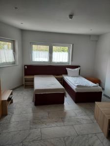 Ein Bett oder Betten in einem Zimmer der Unterkunft Ferienwohnung Machedanz