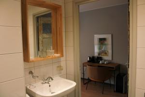 Een badkamer bij HOLT Hotel