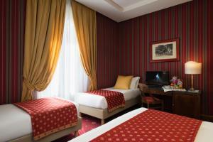 Cama o camas de una habitación en Atlante Garden Hotel