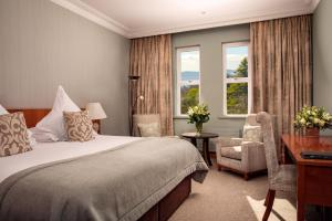 A bed or beds in a room at The Culloden Estate and Spa