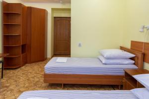 A bed or beds in a room at Санаторий Горки Минобороны России