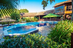 The swimming pool at or near Pousada Arizona