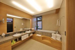 Ein Badezimmer in der Unterkunft Mawell Resort