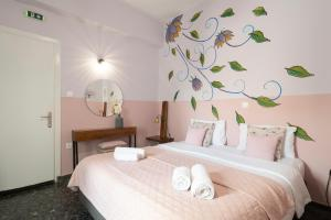 Letto o letti in una camera di Kalamata Art Hotel
