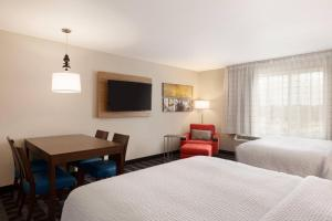 A television and/or entertainment center at TownePlace Suites Cedar Rapids Marion
