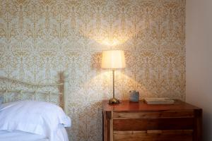 A bed or beds in a room at Quorn Farmhouse