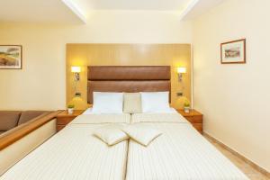 Ένα ή περισσότερα κρεβάτια σε δωμάτιο στο Hotel Europa Olympia