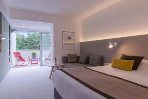 A bed or beds in a room at Hôtel Diana Restaurant & Spa by HappyCulture