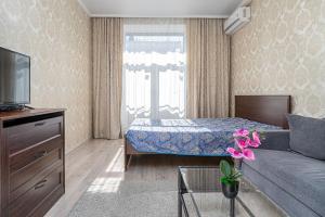Кровать или кровати в номере Апартаменты Казань-центр на Чернышевского 16