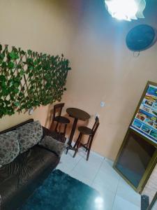 A seating area at Pousada Sol de Iracema Centro