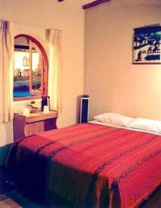 A bed or beds in a room at La Fortaleza del Inca