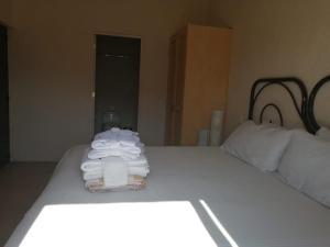 A bed or beds in a room at Hostal de la Luz - Spa Holistic Resort
