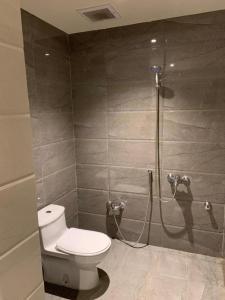 Um banheiro em Manazel Hail Furnished Apartments