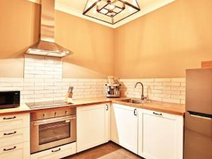A kitchen or kitchenette at Sarnia - period home in garden oasis with pool