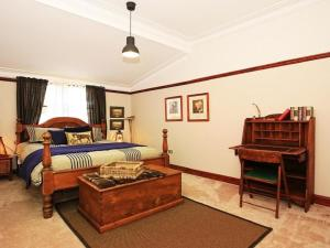 A bed or beds in a room at Sarnia - period home in garden oasis with pool