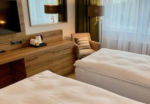 Postel nebo postele na pokoji v ubytování CENTRAL PARK FLORA