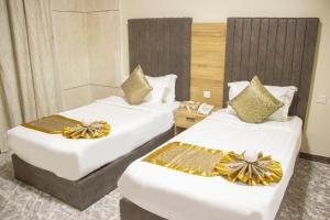 Cama ou camas em um quarto em Lavent Park Hotel Suites