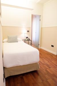 Cama o camas de una habitación en La Bella Sevilla