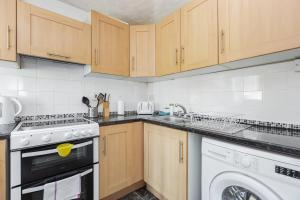 A kitchen or kitchenette at Nightingale Suite