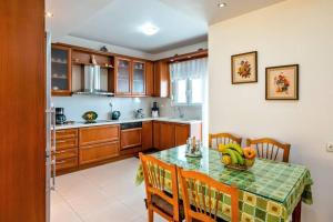 A kitchen or kitchenette at Art Antique House - Ierapetra