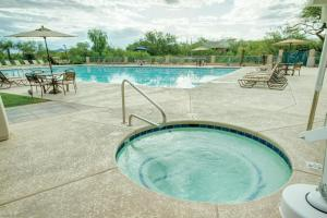 The swimming pool at or near Starr Pass Golf Suites