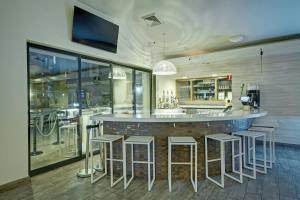 The lounge or bar area at Desert Rose Resort