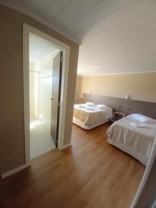A bed or beds in a room at Pousada Rota12