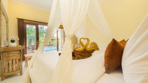 A bed or beds in a room at Abhirama Villas by Supala