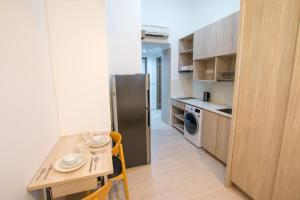 A kitchen or kitchenette at Cantonment Serviced Apartment