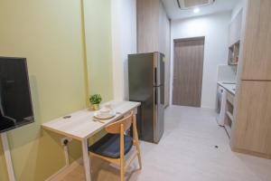 A television and/or entertainment center at Cantonment Serviced Apartment