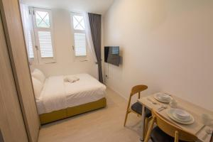 A bed or beds in a room at Cantonment Serviced Apartment