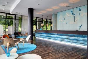 The swimming pool at or near Motel One Rostock
