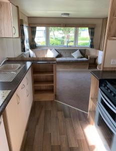 A kitchen or kitchenette at Home from Home Caravan Hire, Haven's Thorpe Park, Cleethorpes