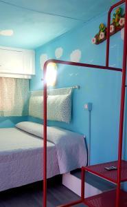 Letto o letti in una camera di New Camping Coccorrocci