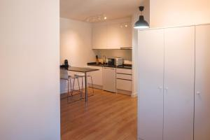 A kitchen or kitchenette at Cozy and convenient studio near to Airport