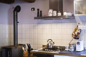 A kitchen or kitchenette at LA PITA AGORDINA