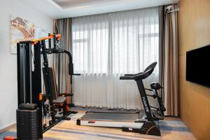 The fitness center and/or fitness facilities at Holiday Inn Express Shanghai Zhenping, an IHG Hotel