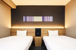 A bed or beds in a room at Hakata Nakasu Washington Hotel Plaza