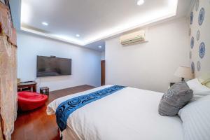 溫暖之巢房間的床