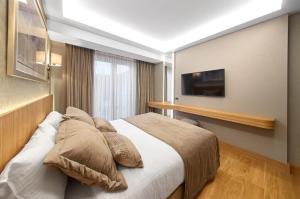 Кровать или кровати в номере Lady Diana Hotel