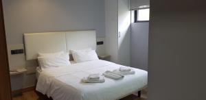 Cama o camas de una habitación en Pensión LO