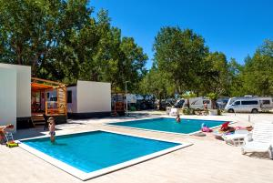 The swimming pool at or close to Mobile Homes Camp Galeb