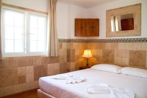 Een bed of bedden in een kamer bij Aparthotel Maracaibo