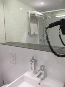 A bathroom at AZIMUT Hotel Vladivostok