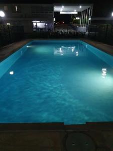 The swimming pool at or near Park Motor Inn