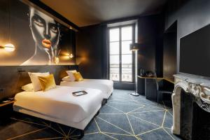 A bed or beds in a room at Leprince Hotel Spa; Best Western Premier Collection