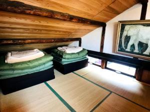 ゲストハウス ヤドカーリにあるベッド