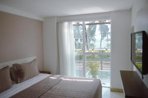 A bed or beds in a room at Nord Easy Ondas do Atlantico
