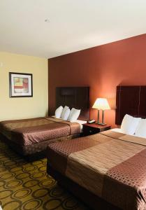 A bed or beds in a room at Rodeway Inn Winnfield
