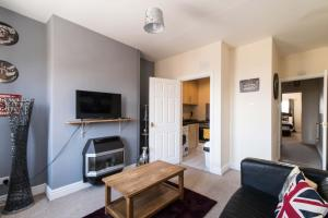 A television and/or entertainment center at Spacious one bedroom apartment with free parking